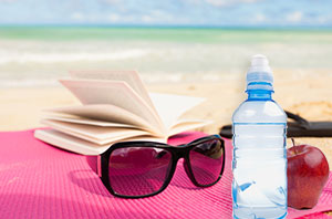Book and Water on the Beach