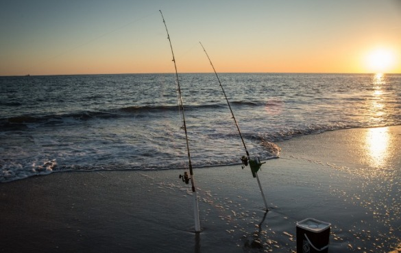 surf fishing gear on the beach | Sunset Vacations