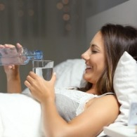 woman pouring water in bed | Sunset Vacations