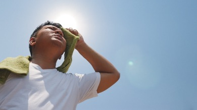 man experiencing heat exhaustion | Sunset Vacations