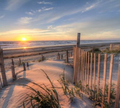early morning sunrise over the beach | Sunset Vacations