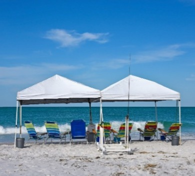 beach cabana with chairs and fishing gear | Sunset Vacations