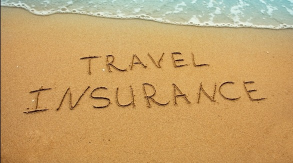 travel insurance written in the sand | Sunset Vacations