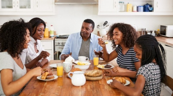 family enjoying breakfast at their beach vacation rental | Sunset Vacations