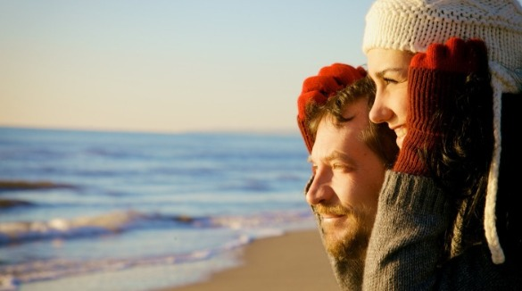 couple on sunset beach in winter | Sunset Vacations