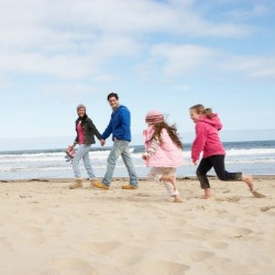 family on sunset beach | Sunset Vacations