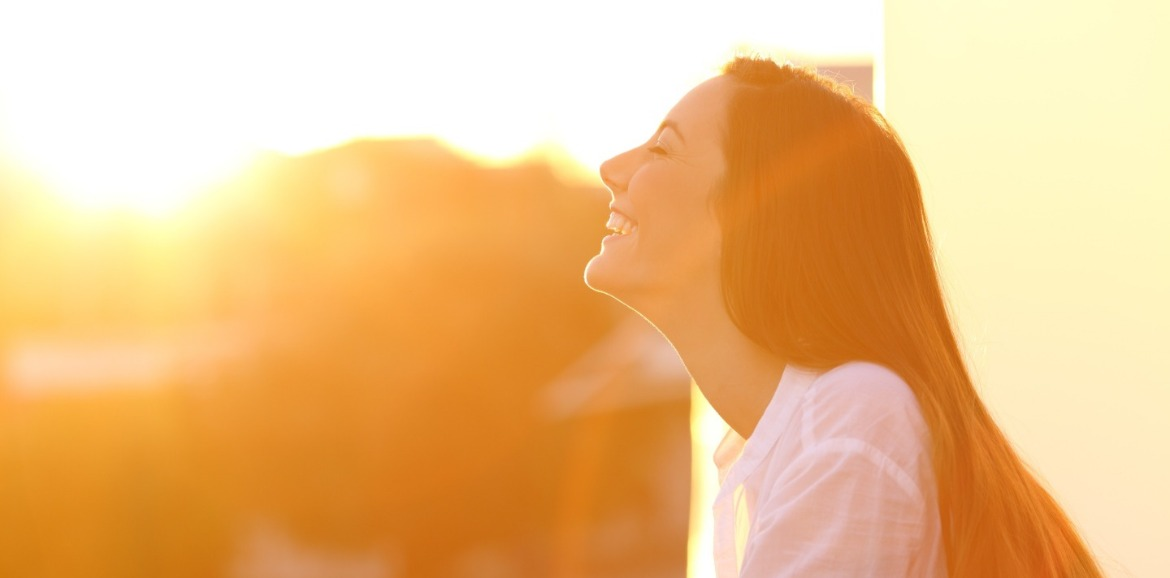 woman enjoying sunshine | Sunset Vacations